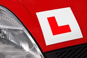 L Plate On Red Car